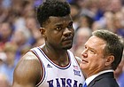Kansas center Udoka Azubuike (35) hugs Kansas head coach Bill Self after coming out of the game with seconds remaining in regulation, Wednesday, March 5, 2020 at Allen Fieldhouse.