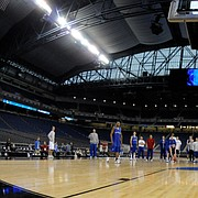 Kansas' Darrell Arthur throws down a windmill dunk during the Jayhawks' open practice at Detroit's Ford Field. KU held a short, public workout Thursday in preparation for tonight's meeting with Villanova.