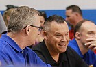 Kansas Athletic Director Jeff Long (left) cheers on the KU volleyball team on Sunday, Aug. 26, 2018, while sitting with women's basketball coach Brandon Schneider.