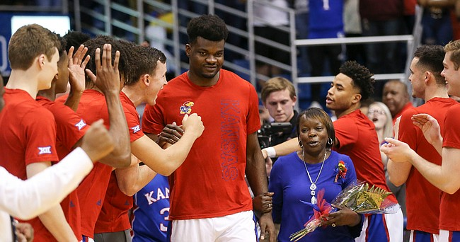 Kansas center Udoka Azubuike (35) is cheered by his teammates as he is introduced to the Allen Fieldhouse crowd on Senior Night.