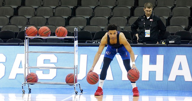 Kansas guard Devon Dotson (1) warms up with some dribbling drills during practice on Wednesday, March 11, 2020 at Sprint Center.