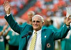 In this Oct. 25, 2009, file photo, former Miami Dolphins head coach Don Shula waves to the crowd during a half time ceremony of an NFL football game between the Miami Dolphins and the New Orleans Saints in Miami. Shula, who won the most games of any NFL coach and led the Miami Dolphins to the only perfect season in league history in 1972, died Monday, May 4, 2020, at his South Florida home, the team said. He was 90.
