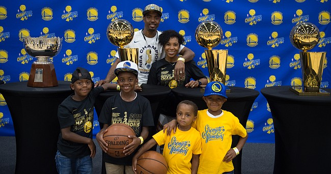 Former Kansas point guard Aaron Miles' and his family, shown here after the Golden State Warriors' NBA title in 2018, have enjoyed being a part of the Warriors' recent success.