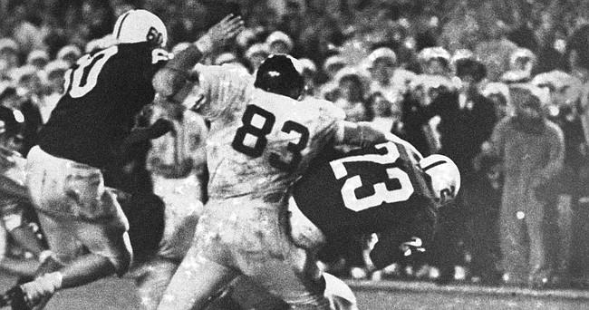 Penn State halfback Bob Campbell (23) plunges over the goal line with the winning 2-point conversion, Jan. 1, 1969 in the Orange Bowl game in Miami. Reaching for Campbell is Kansas defensive end John Zook (83).