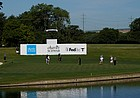 Phil Mickelson, Gary Woodland and Kevin Na play on the 13th green without the presence of a gallery during the first round of the Charles Schwab Challenge golf tournament at the Colonial Country Club in Fort Worth, Texas, Thursday, June 11, 2020.
