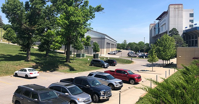 Cars fill the parking lots at the Kansas football facilities on Monday, June 15, 2020, the first day allowed by Big 12 Conference guidelines for football players to return to campus for voluntary workouts in the wake of the COVID-19 pandemic.