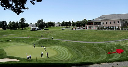 Golfers play on the 18th green during the first round of the Travelers Championship golf tournament at TPC River Highlands, Thursday, June 25, 2020, in Cromwell, Conn.