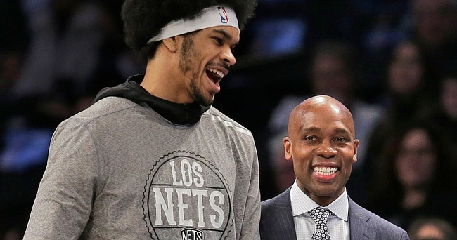Brooklyn Nets interim head coach Jacque Vaughn, right, talks with Jarrett Allen during the first half of an NBA basketball game against the Chicago Bulls at the Barclays Center, Sunday, March 8, 2020, in New York.