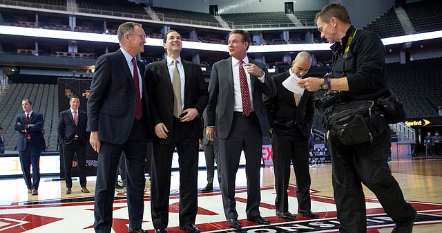 Kansas head coach Bill Self jokes with Oklahoma coach Lon Kruger, Baylor coach Scott Drew and Texas head coach Shaka Smart as they and other coaches assemble for a group photo during Big 12 Media Day on Wednesday, Oct. 24, 2018 at Sprint Center.