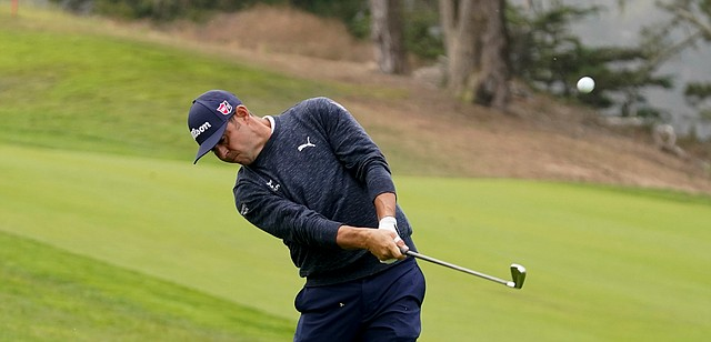 Gary Woodland watches his shot on the 14th hole during the first round of the PGA Championship golf tournament at TPC Harding Park Thursday, Aug. 6, 2020, in San Francisco. (AP Photo/Charlie Riedel)