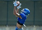 Kansas receiver Lawrence Arnold rises up for a catch during a preseason practice in August of 2020.