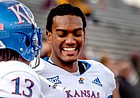 Kansas cornerbacks Hasan Defense and Elijah Jones laugh during the late stages of the football team's road win at Central Michigan.