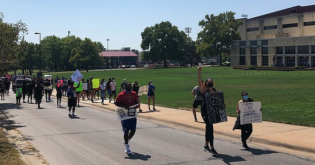 Kansas basketball junior Emma Merriweather led the pack during Friday's march, which came about when Merriweather and her teammates met Thursday to talk about what they could do to fight for social justice.