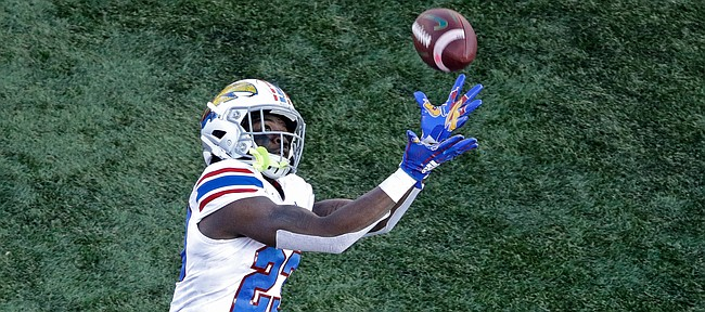 Kansas returner Kenny Logan Jr. (23) misses a punt that was recovered by Baylor during the first half of an NCAA college football game Saturday, Nov. 30, 2019, in Lawrence, Kan. (AP Photo/Charlie Riedel)