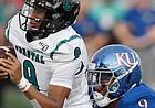 Kansas linebacker Najee Stevens-McKenzie takes down Coastal Carolina's Fred Payton Saturday night at David Booth Kansas Memorial Stadium on Sept. 7, 2019.