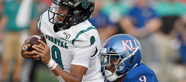 Kansas linebacker Najee Stevens-McKenzie takes down Coastal Carolina's Fred Payton Saturday night at David Booth Kansas Memorial Stadium on Sept. 7, 2019.