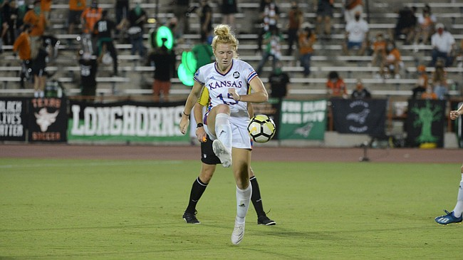 Kansas senior Ceri Holland plays a ball during the Jayhawks' 1-0 victory at Texas in the season opener for both teams on Friday, Sept. 11, 2020.