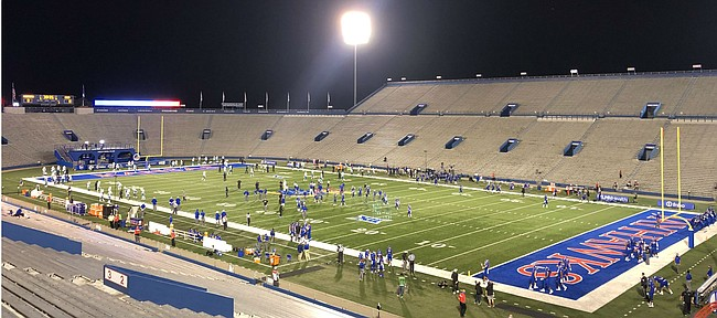 Kansas and Coastal Carolina warm up under the lights on Saturday, Sept. 12, 2020. The game was the season opener for both teams and, with fans not allowed to attend, it featured very few of the normal sights and sounds surrounding David Booth Kansas Memorial Stadium.
