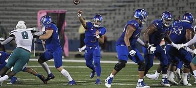 Kansas quarterback Miles Kendrick makes a throw on Sept. 12, 2020, versus Coastal Carolina at David Booth Kansas Memorial Stadium.