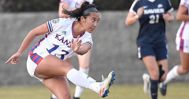 KU senior Kathryn Castro follows a floater toward the net with her eyes during the Jayhawks' 1-0 victory over Texas Tech in the home opener on Friday, Sept. 25, 2020 at Rock Chalk Park.