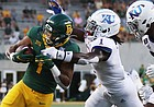 Baylor running back Trestan Ebner, left, gets close to the goal line before getting pulled down by Kansas cornerback Kenny Logan Jr., in the first half of an NCAA college football game, Saturday, Sept. 25, 2020, in Waco, Texas. (Rod Aydelotte/Waco Tribune Herald, via AP)