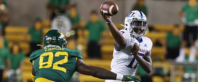 Kansas quarterback Jalon Daniels throws a pass against Baylor in the first half of an NCAA college football game, Saturday, Sept. 25, 2020, in Waco, Texas. (Rod Aydelotte/Waco Tribune Herald, via AP)