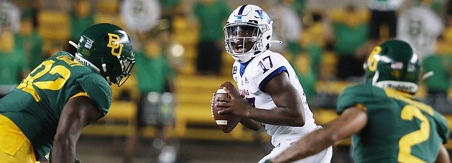 Kansas quarterback Jalon Daniels looks to make a play during a game against Baylor in the first half of an NCAA college football game, Saturday, Sept. 25, 2020, in Waco, Texas. (Rod Aydelotte/Waco Tribune Herald, via AP)