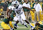 Kansas quarterback Jalon Daniels (17) escapes the tackle by the Baylor defense in the first half of an NCAA college football game in Waco, Texas, Saturday, Sept. 26, 2020. (Jerry Larson/ Waco Tribune Herald, via AP)