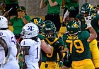 Sep 26, 2020; Waco, Texas, USA; Baylor Bears running back John Lovett (7) celebrates scoring a touchdown against the Kansas Jayhawks during the second half at McLane Stadium. Mandatory Credit: Jerome Miron-USA TODAY Sports