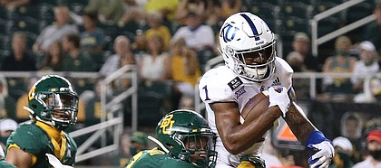 Kansas running back Pooka Williams Jr. (1) scores a touchdown past Baylor linebacker Terrel Bernard (2) in the second half of an NCAA college football game in Waco, Texas, Saturday, Sept. 26, 2020. (Jerry Larson/ Waco Tribune Herald/ pool)