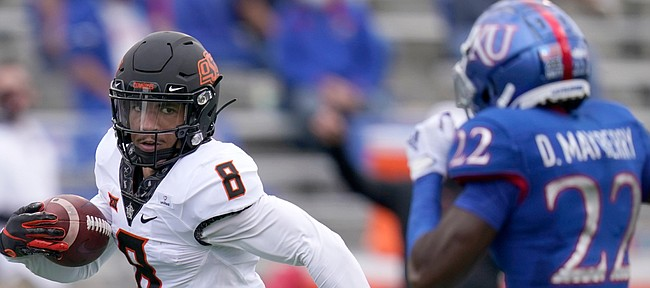 Oklahoma State wide receiver Braydon Johnson (8) runs for a touchdown past Kansas cornerback Duece Mayberry (22) during the first half of an NCAA college football game in Lawrence, Kan., Saturday, Oct. 3, 2020.