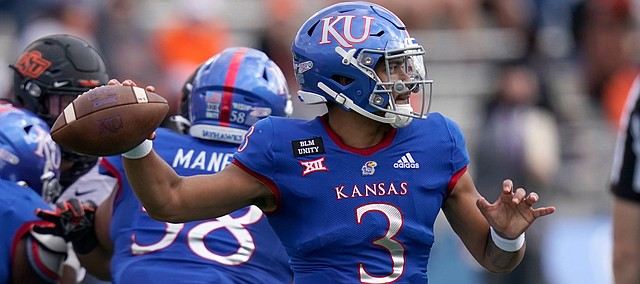 Kansas quarterback Miles Kendrick passes to a teammate during the first half of an NCAA college football game against Oklahoma State in Lawrence, Kan., Saturday, Oct. 3, 2020.
