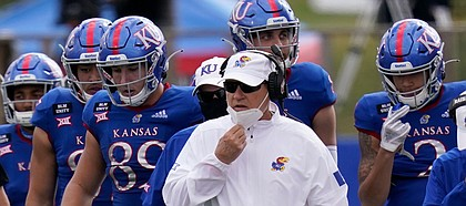 KU coach Les Miles joins his team on the field during KU's 47-7 loss to Oklahoma State on Saturday, Oct. 3, 2020 at David Booth Kansas Memorial Stadium.