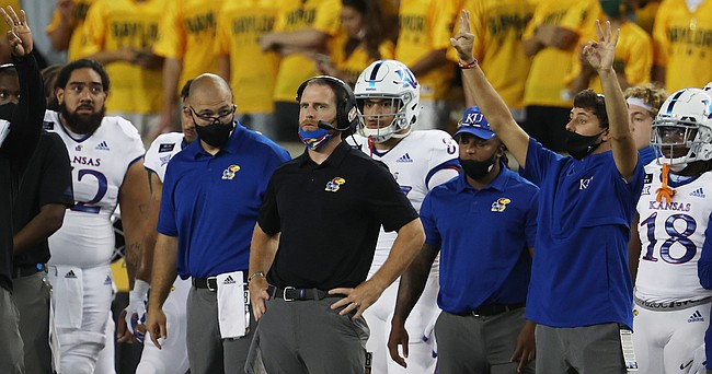 Kansas offensive coordinator Brent Dearmon looks on during their game with Baylor in the first half of an NCAA college football game, Saturday, Sept. 25, 2020, in Waco, Texas. (Rod Aydelotte/Waco Tribune Herald, via AP)