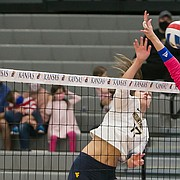 KU's Caroline Crawford (9) and Anezka Szabo (8) elevate at the net for a block attempt during the fourth set of the Jayhawks' five-set loss to the Mountaineers on Saturday, Oct. 10, 2020 at Horejsi Family Volleyball Arena.