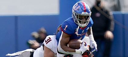 Kansas running back Pooka Williams Jr. (1) is tackled by Oklahoma State safety Kolby Harvell-Peel (31) during the first half of an NCAA college football game in Lawrence, Kan., Saturday, Oct. 3, 2020.