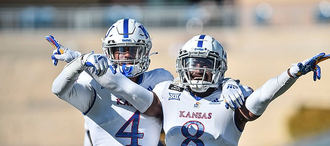 Kansas cornerbacks Elijah Jones and Kyle Mayberry react after breaking up a pass against West Virginia on Saturday, Oct. 16, 2020, in Morgantown, W.Va.