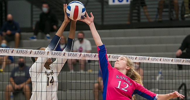 KU freshman Elise McGhie battles with WVU's Briana Lynch at the net during the fourth set of the Jayhawks' five-set loss to the Mountaineers on Saturday, Oct. 10, 2020 at Horejsi Family Volleyball Arena.