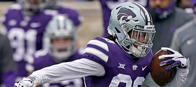 Kansas State wide receiver Phillip Brooks (88) gets past Kansas punter Donovan Gagen (92) as he returns a punt for a touchdown during the first half of an NCAA football game Saturday, Oct. 24, 2020, in Manhattan, Kan. (AP Photo/Charlie Riedel)