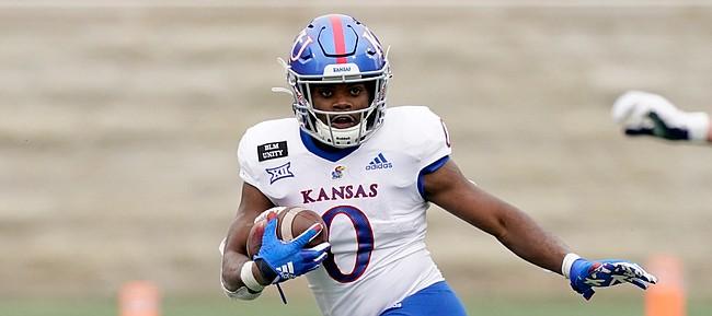 Kansas running back Velton Gardner (0) is chased by Kansas State linebacker Austin Moore (41) during the second half of an NCAA football game Saturday, Oct. 24, 2020, in Manhattan, Kan. Kansas State won 55-14. (AP Photo/Charlie Riedel)