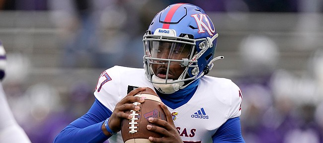 Kansas quarterback Jalon Daniels (17) looks to pass during the first half of an NCAA football game against Kansas State Saturday, Oct. 24, 2020, in Manhattan, Kan. (AP Photo/Charlie Riedel)