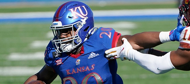 Kansas running back Daniel Hishaw Jr. (20) gets past Iowa State defensive back Lawrence White IV (11) for a touchdown during the first half of an NCAA college football game in Lawrence, Kan., Saturday, Oct. 31, 2020. (AP Photo/Orlin Wagner)
