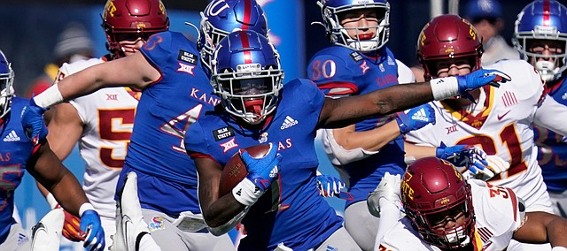 Kansas return specialist Kenny Logan Jr. (1) breaks away from Iowa State defenders Gerry Vaughn (32) and Vonzell Kelley III (29) for a 100-yard touchdown kickoff return during the second half of an NCAA college football game in Lawrence, Kan., Saturday, Oct. 31, 2020. (AP Photo/Orlin Wagner)