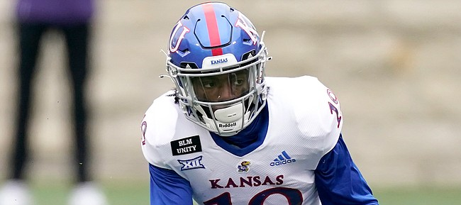 Kansas wide receiver Steven McBride runs the ball the first half of an NCAA football game against Kansas State Saturday, Oct. 24, 2020, in Manhattan, Kan. (AP Photo/Charlie Riedel)