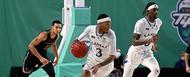 Kansas redshirt freshman Dajuan Harris brings the ball up the floor during a game against Saint Joseph's on Friday Nov. 27, 2020. The Jayhawks earned a 94-72 win over the Hawks in the Rocket Mortgage Fort Myers Tip-Off at the Suncoast Credit Union Arena in Fort Myers, Florida.