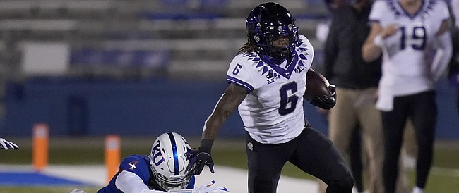 TCU running back Zach Evans (6) gets past Kansas cornerback Elijah Jones (4) during the first half of an NCAA college football game in Lawrence, Kan., Saturday, Nov. 28, 2020. (AP Photo/Orlin Wagner)