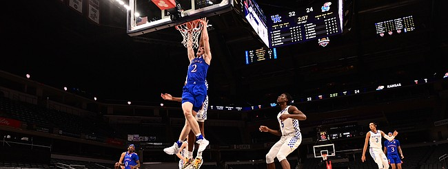 Kansas sophomore Christian Braun finishes off a dunk during a game against Kentucky Tuesday night during the Champions Classic inside Bankers Life Fieldhouse in Indianapolis on Dec. 1, 2020. Photo courtesy of Phil Ellsworth of ESPN.