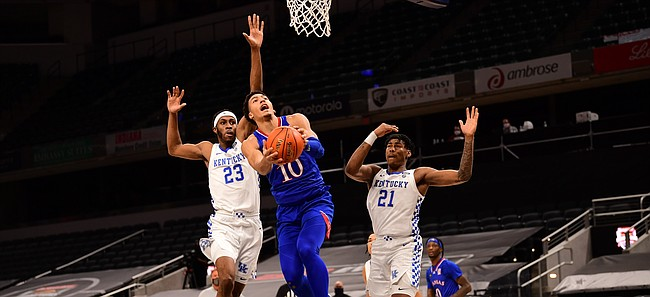 Kansas redshirt freshman Jalen Wilson goes up for a reverse layup during a game against Kentucky Tuesday night during the Champions Classic inside Bankers Life Fieldhouse in Indianapolis on Dec. 1, 2020. Photo courtesy of Phil Ellsworth of ESPN.