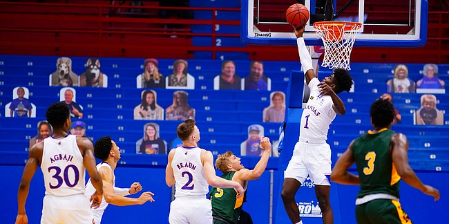 Kansas guard Tyon Grant-Foster (1) rejects a shot from North Dakota State Bison forward Grant Nelson (4) with seconds remaining in regulation on Saturday, Dec. 5, 2020 at Allen Fieldhouse.
