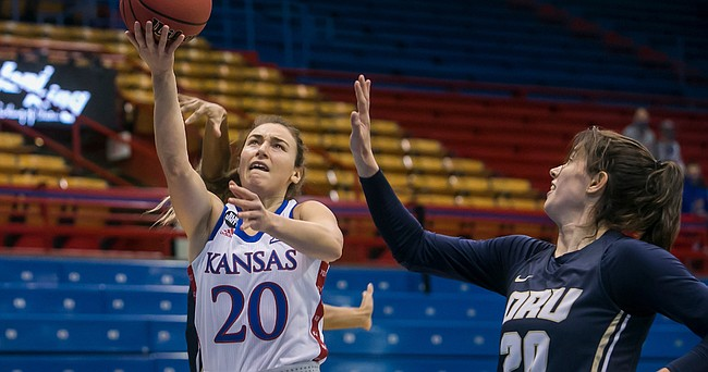 KU senior Julie Brosseau, a graduate transfer from Canada, goes in for two of her game-high 25 points during the Jayhawks' 100-59 win over Oral Roberts on Sunday, Dec. 6, 2020, at Allen Fieldhouse.